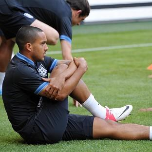 Theo Walcott has a tight hamstring and is fighting to be fit for the Ukraine match