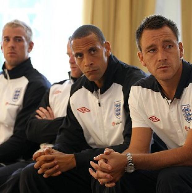 Rio Ferdinand (centre) recalls his early England days when players were divided into cliques