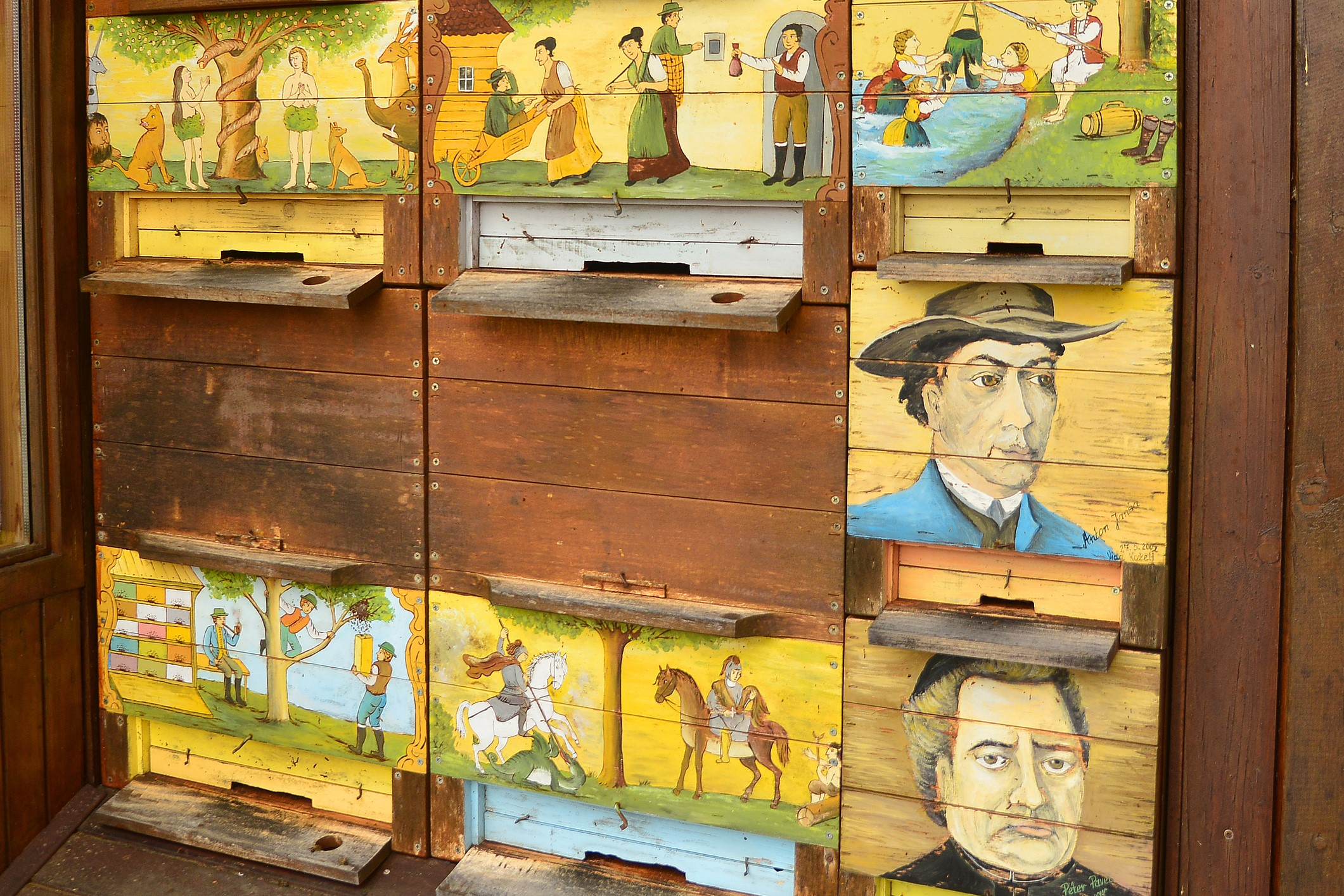 Traditional painted Slovenian bee hives. Photo: Matic Stojs