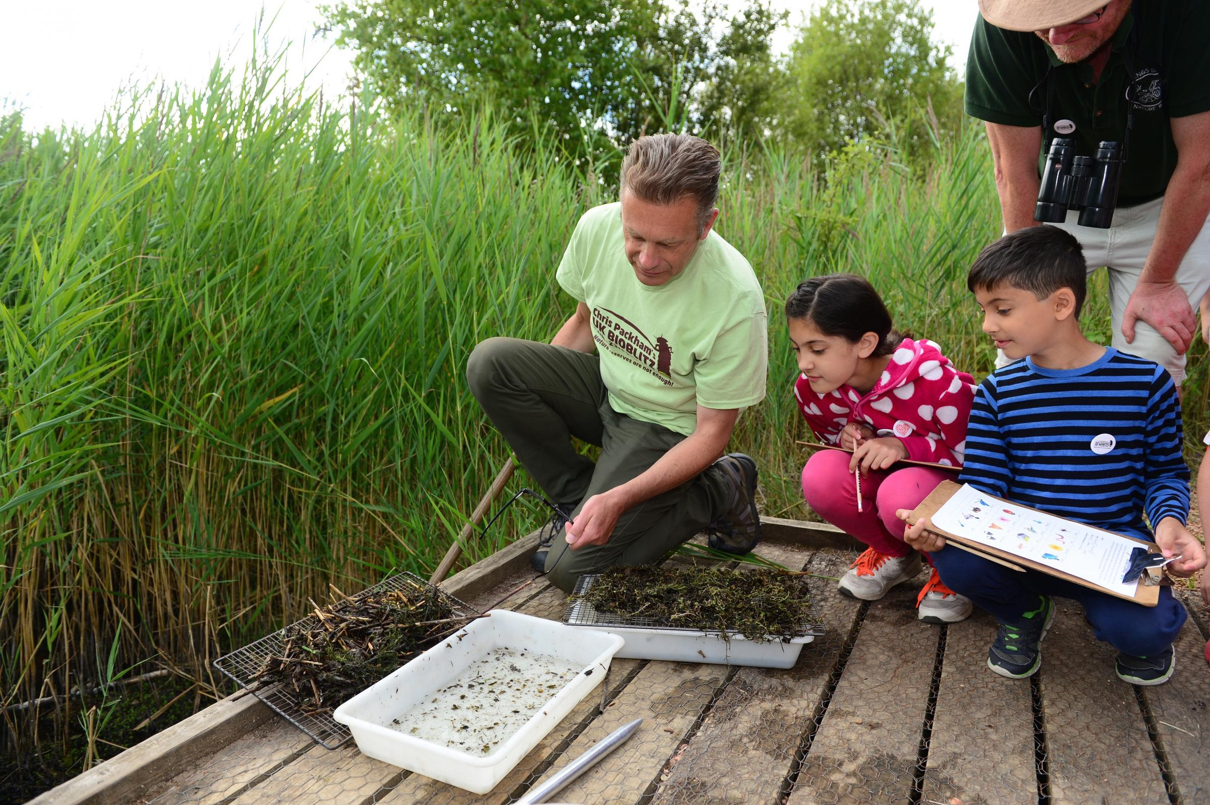 Chris Packham with Anna (10) and Hari (7) Lefley from Whittlesey and Philip Parker from Kings Dyke nature reserve