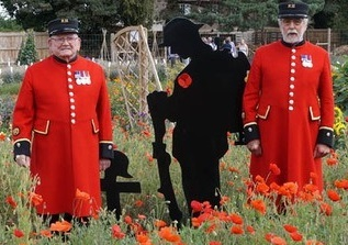 Chelsea Pensioners Dewi Treharne and Mike Paling in the Poppy Garden