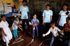 Children and volunteers play in the classroom
